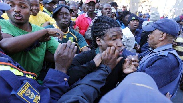 Police restrain Malema supporter