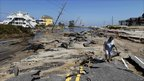 Residents walk along Highway 12 in Cape Hatteras, 28 August 2011