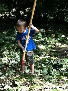 Jennifer Davis' son Wyatt helping clear fallen tree debris