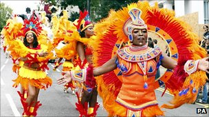 Performers taking part in the Notting Hill Carnival in west London on Monday