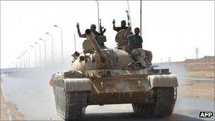 Libyan rebels on a tank move towards Bin Jawad (30 Aug 2011)
