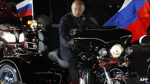 Russian Prime Minister Vladimir Putin  rides into Novorossiysk, 29 August 