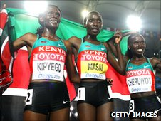 Sally Kipyego, Linet Masai and Vivian Cheruiyot of Kenya celebrate after the women's 10,000 metres in Daegu