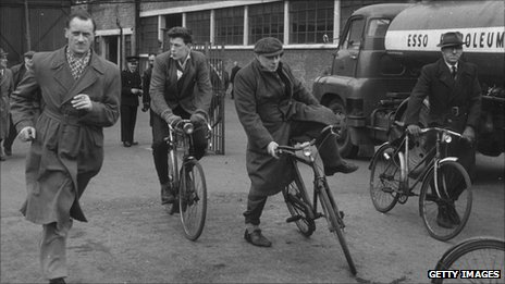 Workers leave a factory in 1956