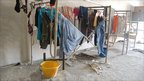 Workers' washing dries on racks