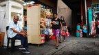 Two Malaysian women walk through a market