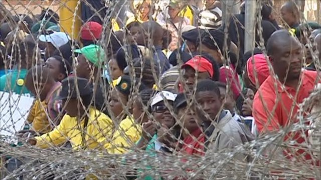Supporters of Julius Malema behind barbed wire barriers in Johannesburg