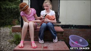 two girls sitting on a step