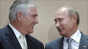Exxon Mobil boss Rex Tillerson shakes hands with Prime Minister Vladimir Putin in Sochi