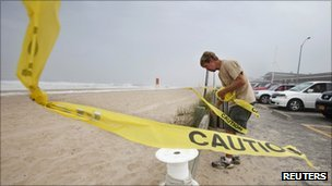 A beach in East Hampton Village being cordoned off last week ahead of Hurricane Irene