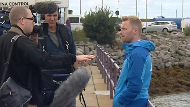 Charity swimmer Ronan Keating being interviewed by the media
