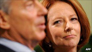 Australian Prime Minister Julia Gillard (r) listens to Former British Prime Minister Tony Blair
