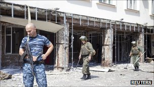 Sappers work at the scene of one of the bomb blasts in Grozny, 31 August