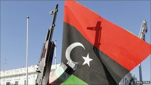 Kingdom of Libya flag and rifle