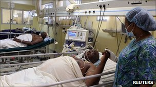 People injured in the bombing of the UN building in Abuja are treated in hospital, 28 August 2011