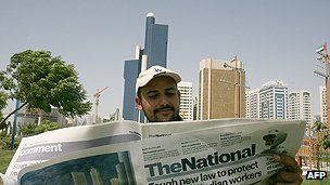 Newspaper reader in Abu Dhabi
