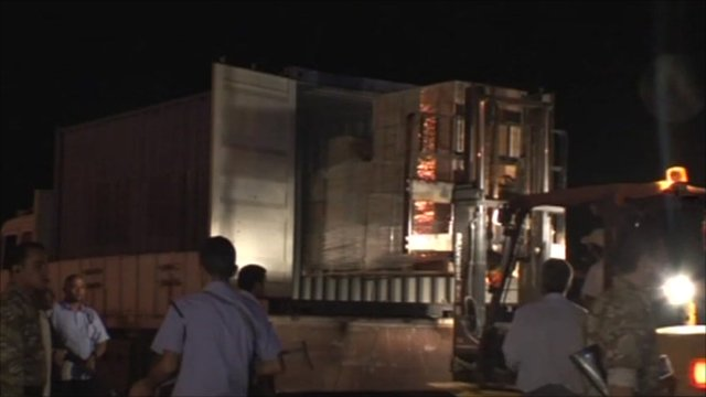 Pallets of cash be transported at Benghazi airport