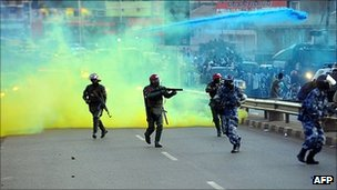 Ugandan anti-riot personnel fire teargas to disperse supporters of Ugandan opposition leader Kizza Besigye (May 2011)