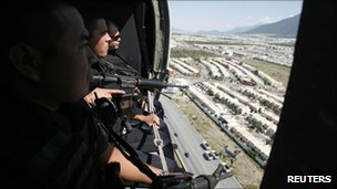 Federal police in a helicopter patrol Monterrey on 29 August 2011