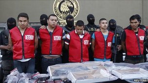 State investigations agents escort five men arrested in connection with an attack on a casino during a presentation in Monterrey 30 August 2011