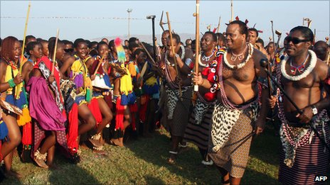 Unmarried Swazi women dance for King Mswati III (2nd r) at Ludzidzini Royal Residence near the capital, Mbabane on 29 August
