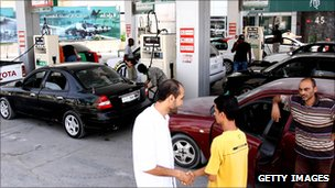Libyans at a petrol station