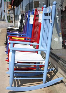A row of chairs outside a shop