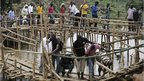 People crossing makeshift bridges