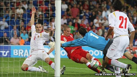 Wales striker Steve Morison slides in to score his first international goal
