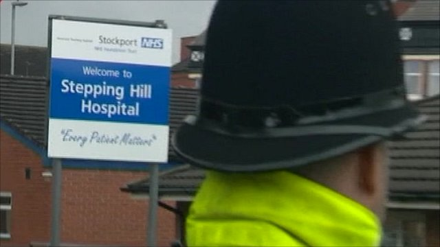 Police officer outside Stepping Hill Hospital