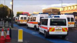 Riot vans around bus