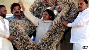 Mayawati wearing a garland of 1,000 rupee notes in March 2010