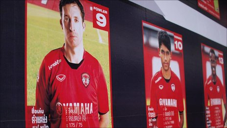 Posters showing Muang Thong players in their strip