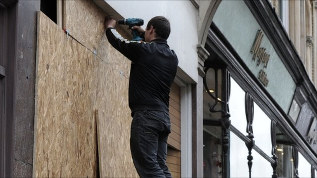 Shop being boarded up in London