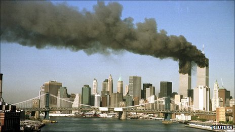 The twin towers of the World Trade Center pour smoke in New York in this 11 September 2001 file photo.