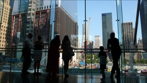 Visitors look over Ground Zero