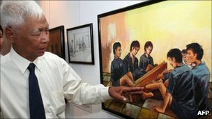 File image from 12 July 2007 showing Vann Nath with one of his paintings