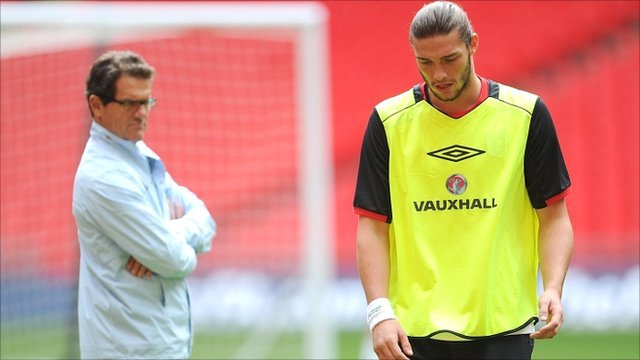 Fabio Capello watches Andy Carroll in England training