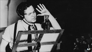 Orson Welles broadcasts his radio show of H G Wells' science fiction novel The War of the Worlds in a New York studio on 30 October 1938.