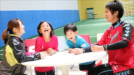 Dai Saito and his family at an indoor football centre in Tokyo