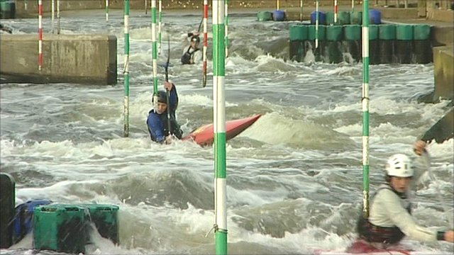 Canoeists traverse white water at the National Watersports Centre in Nottingham