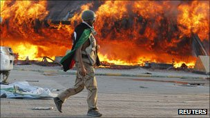 Gaddafi compound in flames