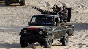 Anti-Gaddafi fighters patrol near the town of al Washka some 140km (87 miles) west of Sirte.