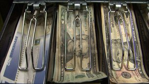 cash register holding US dollars and Berkshares