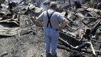 Willie Clements surveys his fire-destroyed home in Bastrop, Texas. (6 Sept)
