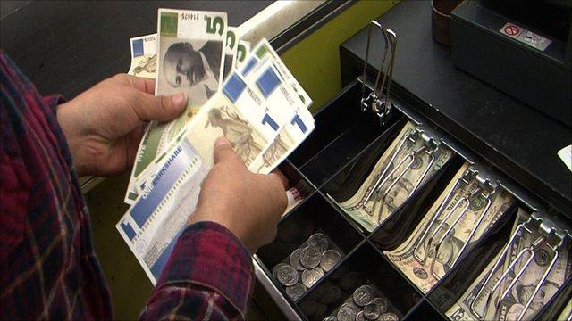Cashier counting bills of BerkShares