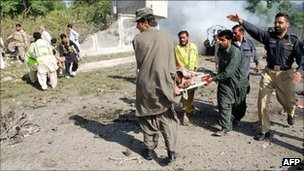 Pakistani security personnel and volunteers carry injured blast victims at the site of a suicide bomb attack in Quetta on September 7