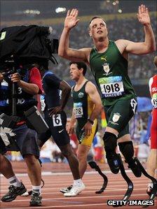 TV cameraman films Oscar Pistorius at Beijing Paralympics