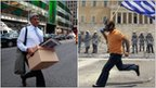 Left: employee leaves the Lehman Brothers headquarters in New York following the firm's collapse in September 2008; Right: anti-austerity rioter in Athens carries the Greek flag