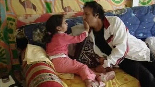 Gaddafi with child